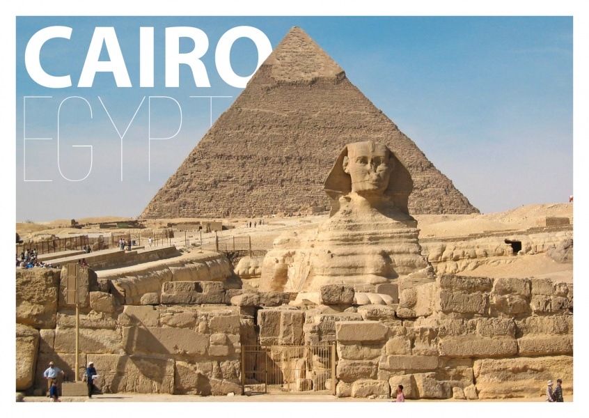 Photo of sphinx statue with pyramid in the background
