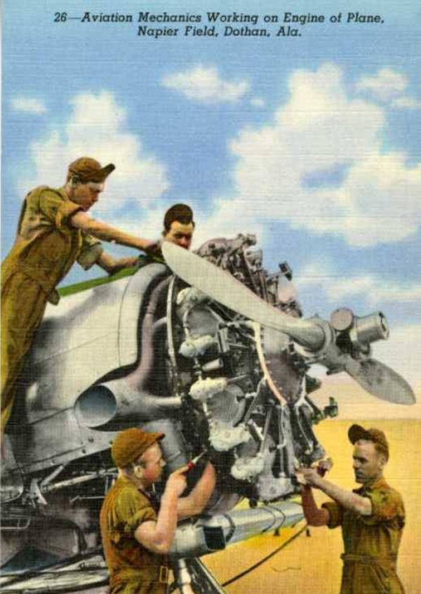 Curt Teich Postcard Archives Collection Aviation Mechanics working in engine of plane