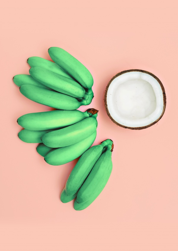 Kubistika green bananas with open coconut
