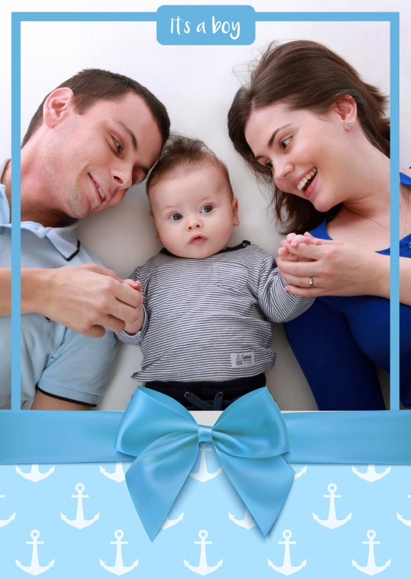 It's a boy with blue bow and anchor pattern as background