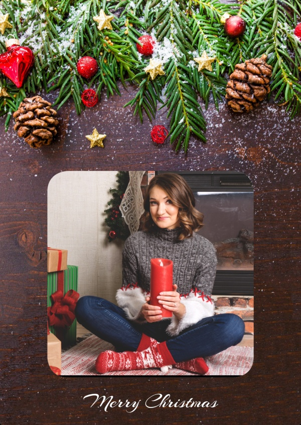 Festive template in wood appearance and Christmas decoration, pinecones, snow, pine tree
