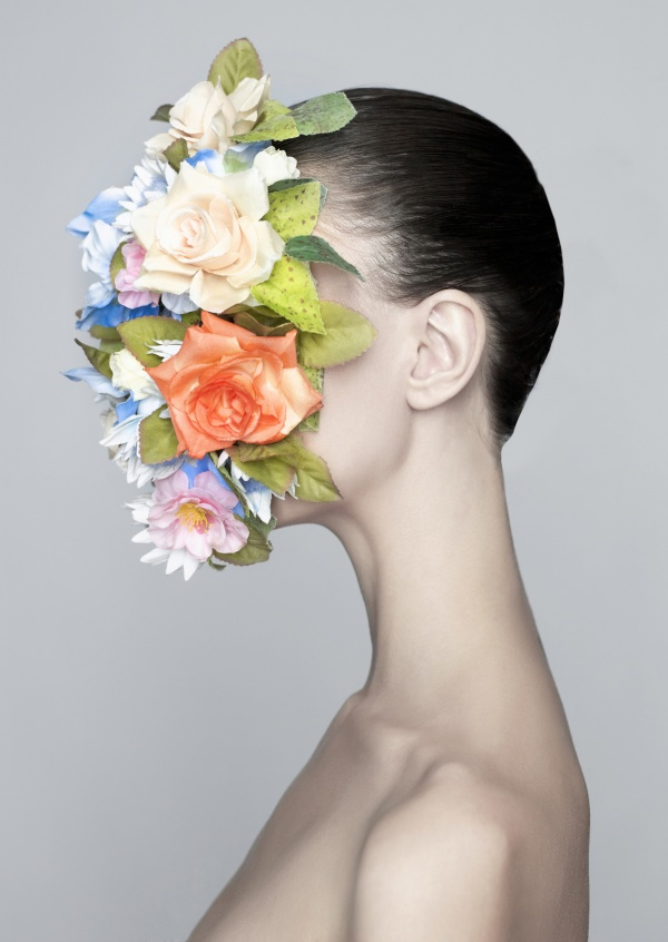 Kubistika girl with flowers in fron of her face