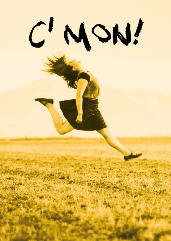 Photo of a young woman, jumping on a field in yellow