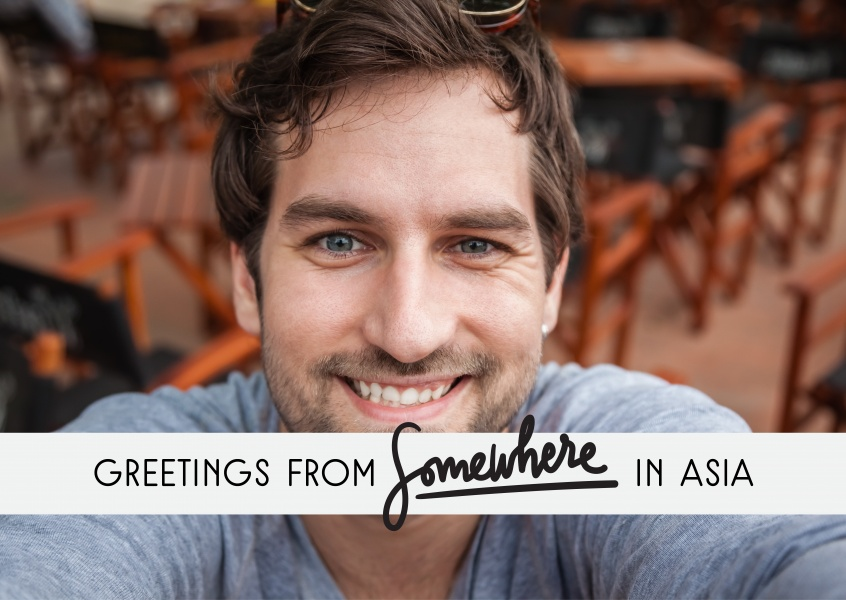 Greetings from Somewhere in Asia black text on grey rectangle