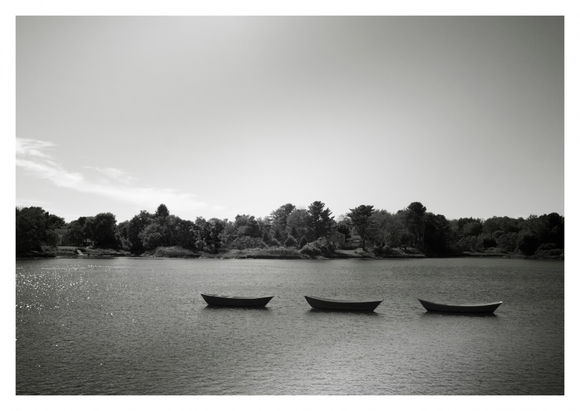 black n white photo of 3 boats on a river