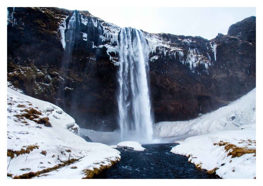Huge waterfall in winter landscape
