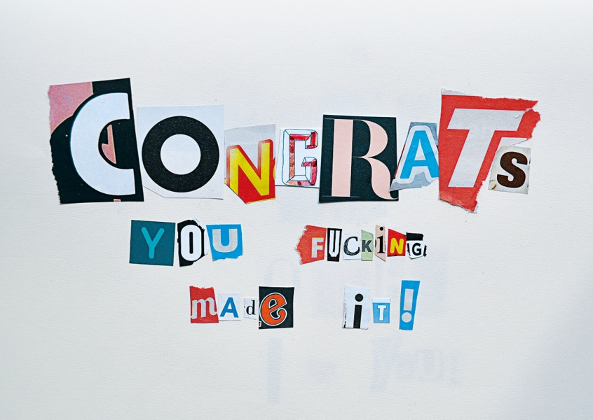 colourful newspaper snippets that make up the message congrats you f*cking made it
