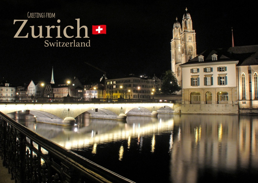 postcard with photo of zurich at evening with lettering: greetings from zurich