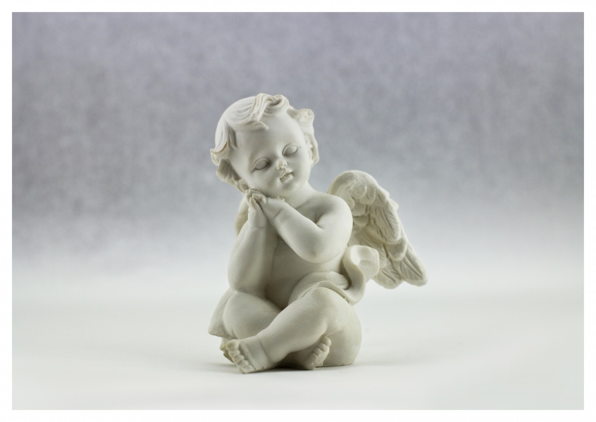black n white photo of little angel statue