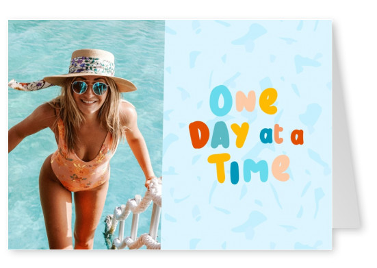 postcard saying One day at a time