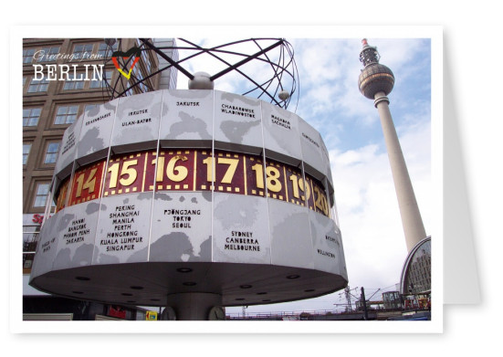 Photo of the world clock  on Berlin, Alexanderplatz with TV tower in the background–mypostcard