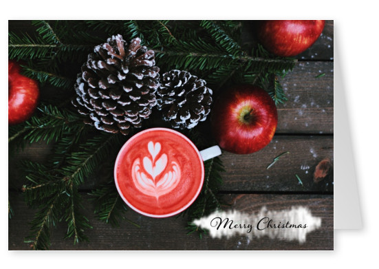 Merry Christmas on wood floor with pinecones, apples, Christmas tree