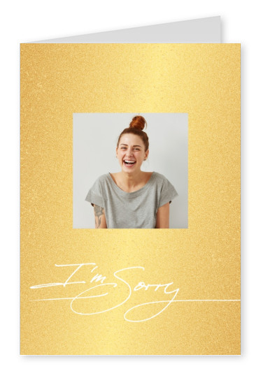 Sorry in write handletting on golden shiny background