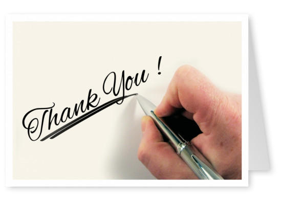 Saying thanks handwirtten with a pen