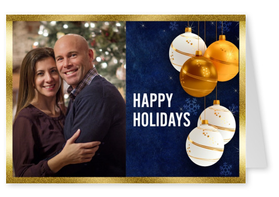 christmas balls with golden frame and blue background