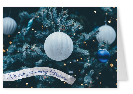 Christmas greeting card wishes merry Christmas with a christmas tree and christmas balls in blue