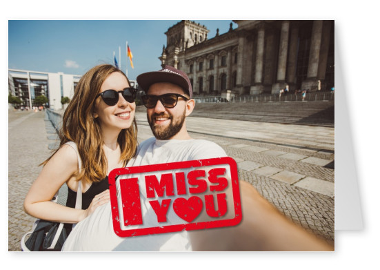 red stamp saying I miss you in destroyed lettering