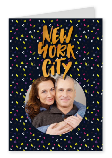 new york golden lettering with colourful geometric pattern on black ground