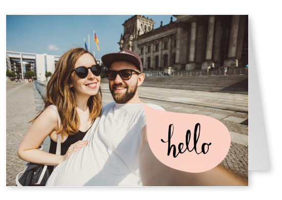 pastel pink speech bubble with hello handwritten in black