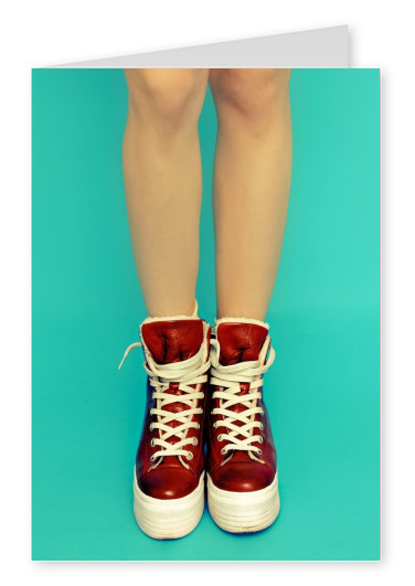 Kubistika red sneakers and girl's legs