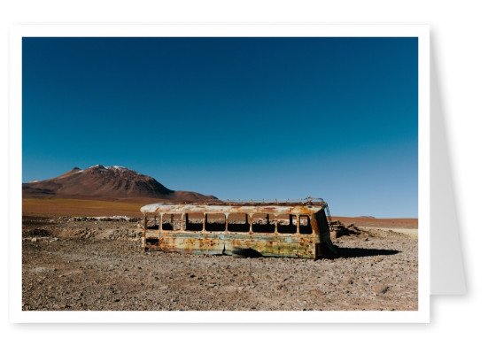 Fucked-up schoolbus in the desert