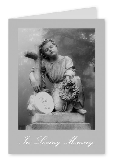 photo statue boy with cross