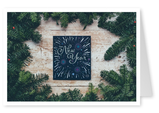 happy new year card photo christmas branches on wood with sign