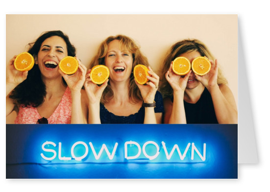 photo neon lights saying slow down