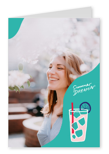 Summer dreamin text. Cocktail on a turquoise background