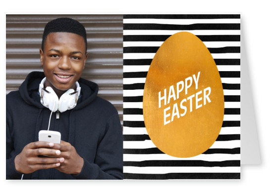 Golden Easter egg on black and white striped background–mypostcard