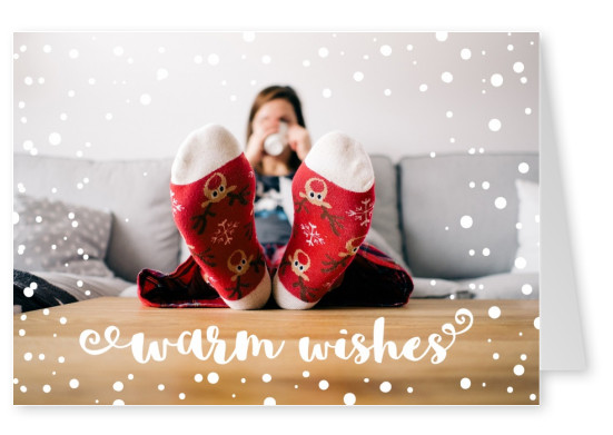 Woman in sofa weating socks, warm wishes