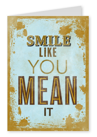 Saying smile like you mean it in different fonts and colours on a bright background with splash pattern