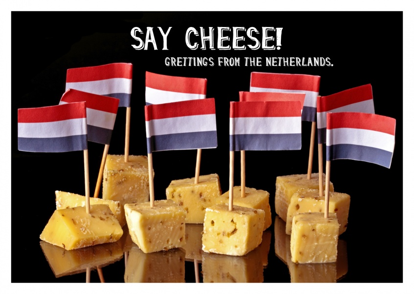 Photo of Dutch flags on cheese bits and quote say cheese–mypostcard