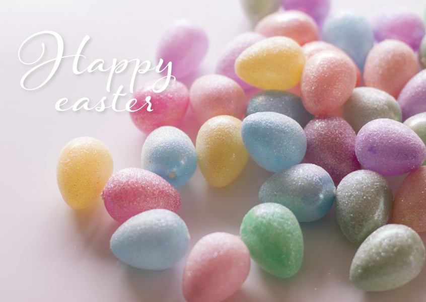 Easter eggs in pastel colours and happy easter wishes–mypostcard