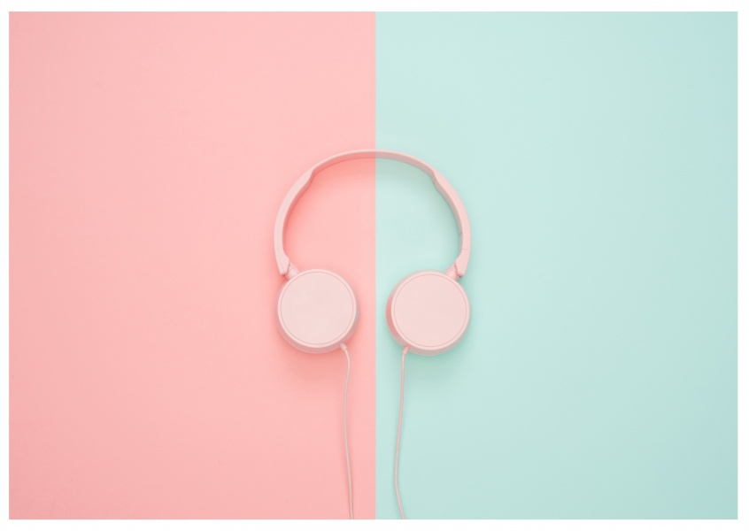 photo headphones with pastel coloured background