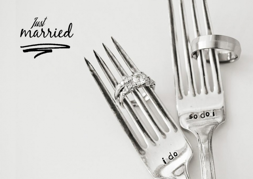 two forks with wedding rings