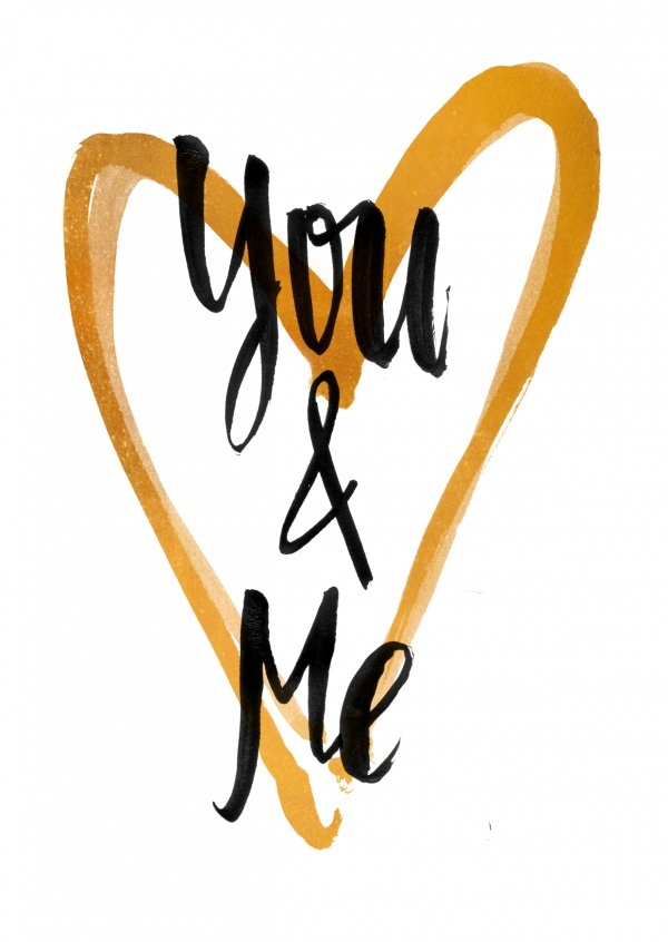 You & Me in black calligrpahy lettering on golden heart and white background