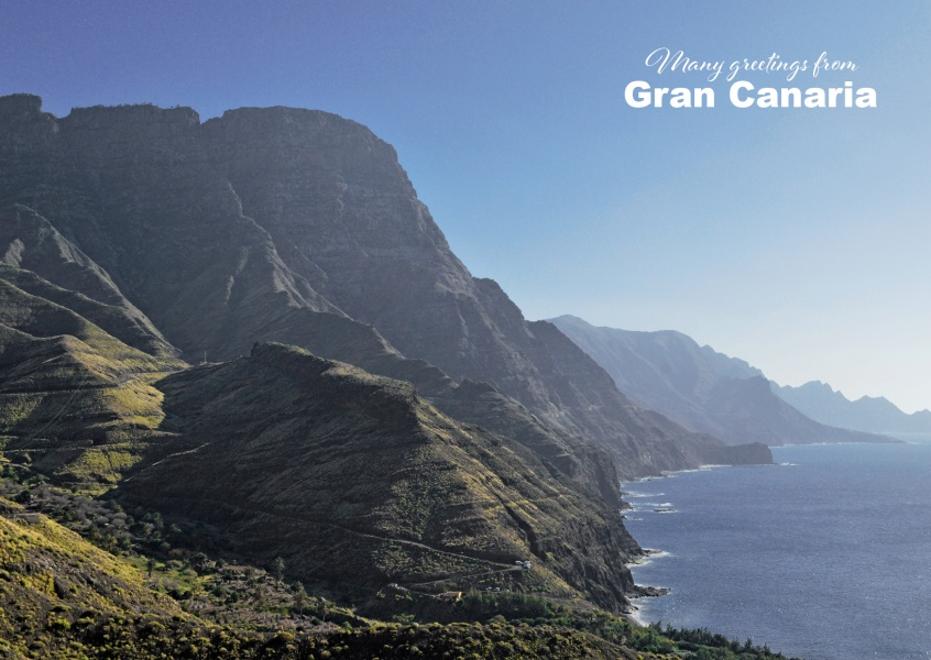 Photo of Gran Canaria's coastal view with rocks and blue ocean–mypostcard