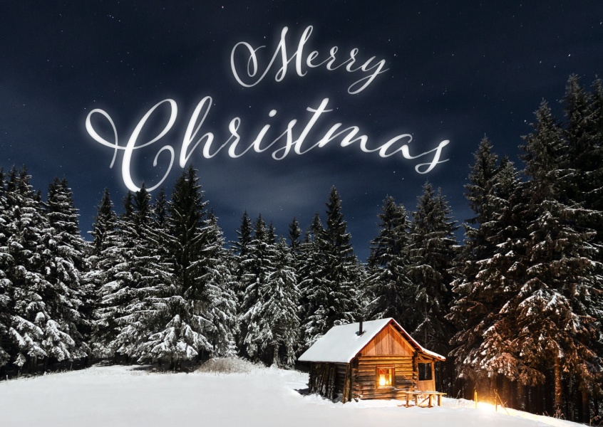 Merry Christmas-lettering on snowy landscape