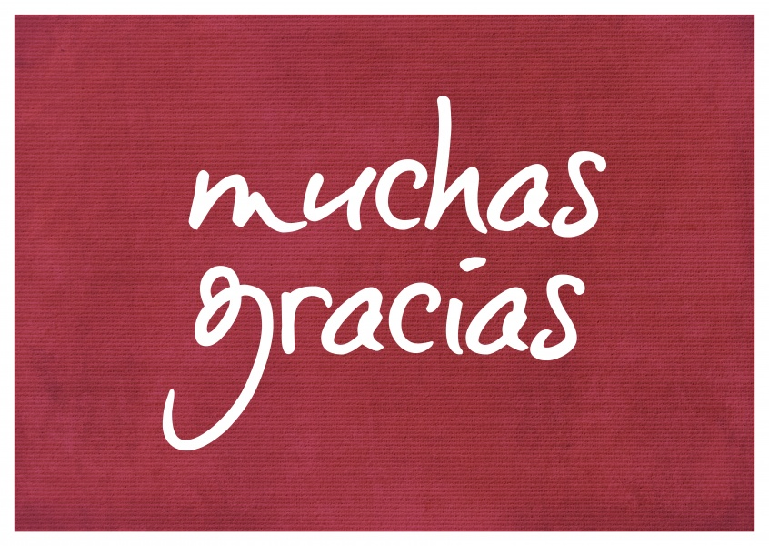 Muchas gracias in white handwriting on red carpet texture–mypostcard