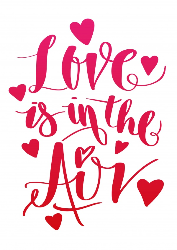 Love is in the air in red handwriting with heart