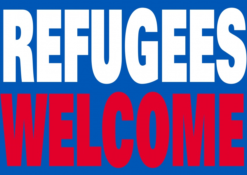 refugees welcome lettering an blue background