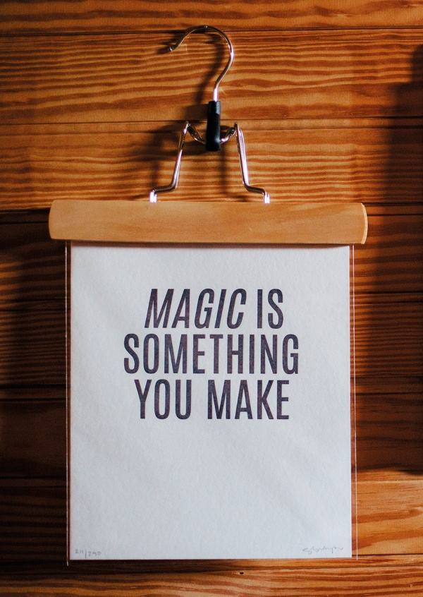 coat hook that holds a sign saying magic is something you make