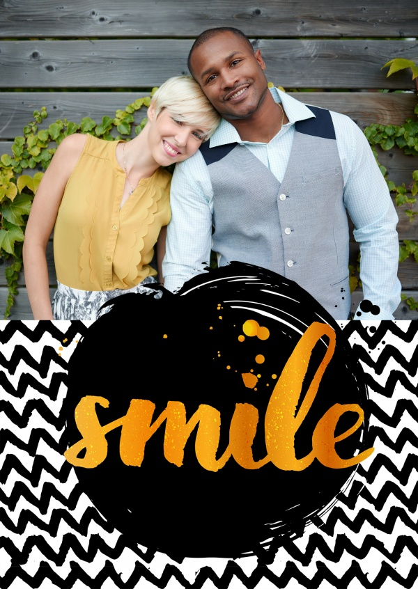 smile in yellow handlettering with black and white zigzag pattern as background