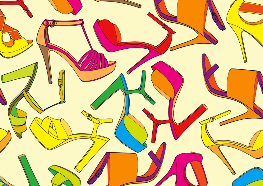 Many colorful female shoes on abstract yellow background