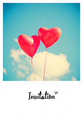 polaroid photo of two heart-shaped balloons
