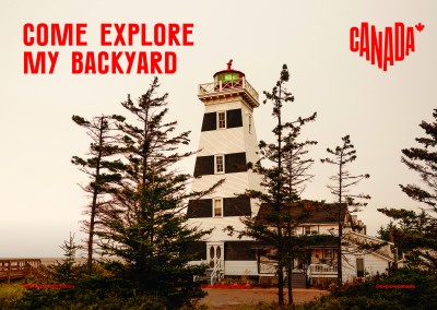 postcard saying Come explore my backyard, West Point Lighthouse, Prince Edward Island - Destination Canada