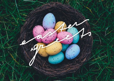easter greets basket with colorful easter eggs