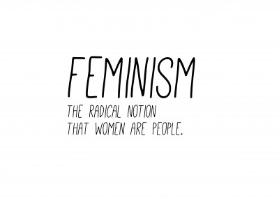 white Card with the definition of feminism