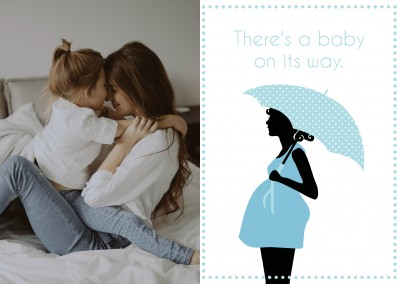 silhouette of pregnant woman with umbrella and polkadot frame